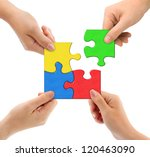 Hands And Puzzle Isolated On...