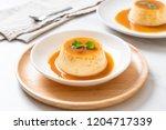 homemade caramel custard...   Shutterstock . vector #1204717339
