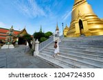 woman tourist is traveling and... | Shutterstock . vector #1204724350