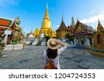 woman tourist is traveling and... | Shutterstock . vector #1204724353