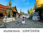 woman tourist is traveling and... | Shutterstock . vector #1204724356