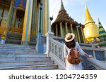 woman tourist is traveling and... | Shutterstock . vector #1204724359