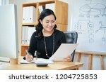 smiling asian female... | Shutterstock . vector #1204725853