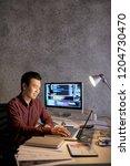 smiling asian it engineer happy ... | Shutterstock . vector #1204730470