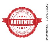 red authentic grunge stamp on... | Shutterstock . vector #1204733659