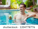 handsome man with mojito... | Shutterstock . vector #1204778776