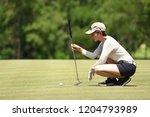 woman golfer check line for... | Shutterstock . vector #1204793989