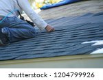 worker install new shingle on... | Shutterstock . vector #1204799926