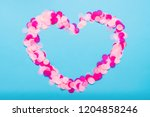 heart shaped pink confetti on a ... | Shutterstock . vector #1204858246