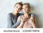beautiful senior mom and her... | Shutterstock . vector #1204874896