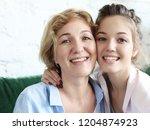 beautiful senior mom and her... | Shutterstock . vector #1204874923