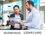 positive latin man showing... | Shutterstock . vector #1204911490