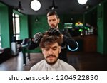 handsome bearded man at the... | Shutterstock . vector #1204922830