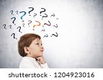 adorable little boy in white... | Shutterstock . vector #1204923016
