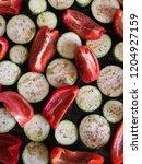 raw vegetables slices pattern... | Shutterstock . vector #1204927159