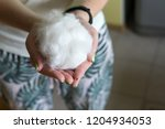 wool in a man's hand against... | Shutterstock . vector #1204934053