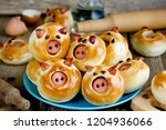 pig buns stuffed with sausage   ... | Shutterstock . vector #1204936066