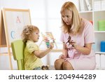 female psychologist working... | Shutterstock . vector #1204944289