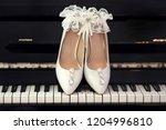 White Wedding Shoes Of Bride I...