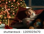 cute boy sleeping in the living ... | Shutterstock . vector #1205025670