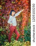 beautiful girl in the autumn... | Shutterstock . vector #1205103250
