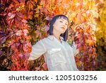 beautiful girl in the autumn... | Shutterstock . vector #1205103256