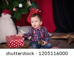 small boy with christmas gifts... | Shutterstock . vector #1205116000