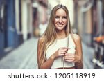 smiling young woman in urban... | Shutterstock . vector #1205118919