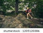 trail running girl in green... | Shutterstock . vector #1205120386