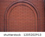 red brick wall with brick arch | Shutterstock . vector #1205202913