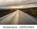 A Curvy Asphalt Road Leading...