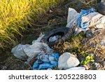 rural pile of trash  tire | Shutterstock . vector #1205228803