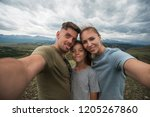 selfie of family in mountain ... | Shutterstock . vector #1205267860