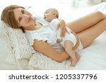 mom and baby  | Shutterstock . vector #1205337796