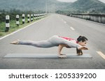 asia woman with sport bra doing ... | Shutterstock . vector #1205339200