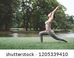 fitness asian woman doing yoga... | Shutterstock . vector #1205339410