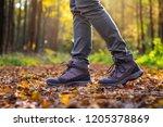 woman is wearing hiking boot... | Shutterstock . vector #1205378869