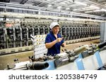 worsted woolen factory in... | Shutterstock . vector #1205384749