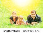 family outdoors playing in the... | Shutterstock . vector #1205423473