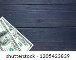 american dollar money on a dark ... | Shutterstock . vector #1205423839