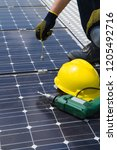 fitting photovoltaic panels on... | Shutterstock . vector #1205492716