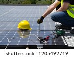 fitting photovoltaic panels on... | Shutterstock . vector #1205492719