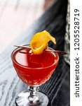 red cocktail with garnish | Shutterstock . vector #1205528719