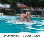 joyful mother with a baby bathe | Shutterstock . vector #1205534206