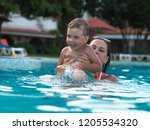 joyful mother with a baby bathe | Shutterstock . vector #1205534320