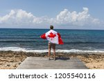 a man stands on the pier and... | Shutterstock . vector #1205540116