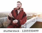 young confident dandy playboy... | Shutterstock . vector #1205550499