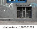 messy grey facade  window with... | Shutterstock . vector #1205551039