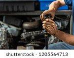 car mechanic or serviceman... | Shutterstock . vector #1205564713