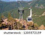 a cable car gondola moves... | Shutterstock . vector #1205572159